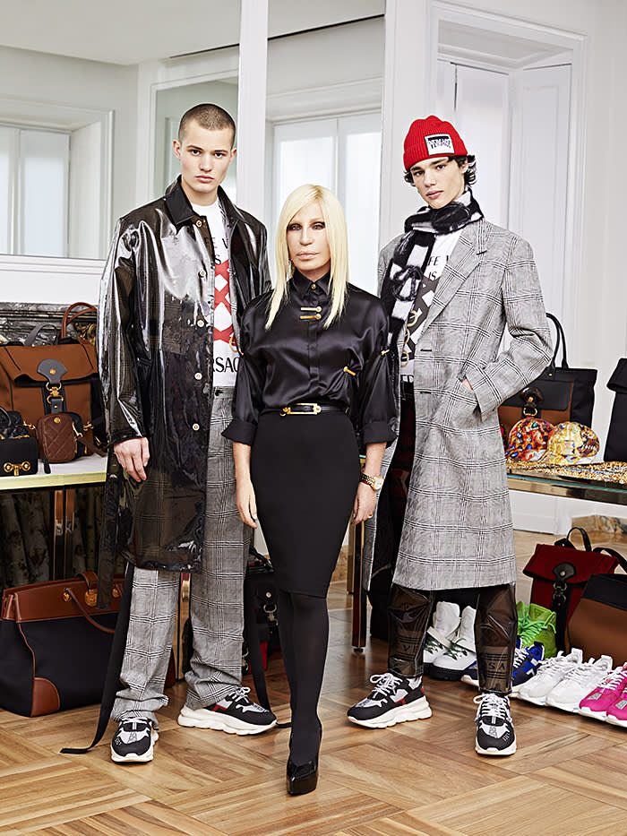 Donatella Versace at her Milan headquarters with models from her upcoming menswear show