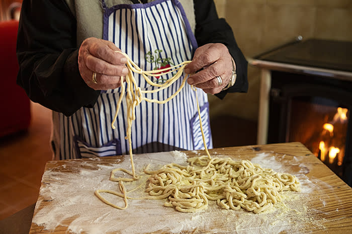 Guiseppina Spiganti, 92, known as Peppa, is one of the 'Pasta Grannies'. Here she makes hand-rolled 'pici' at her home in Tuscany