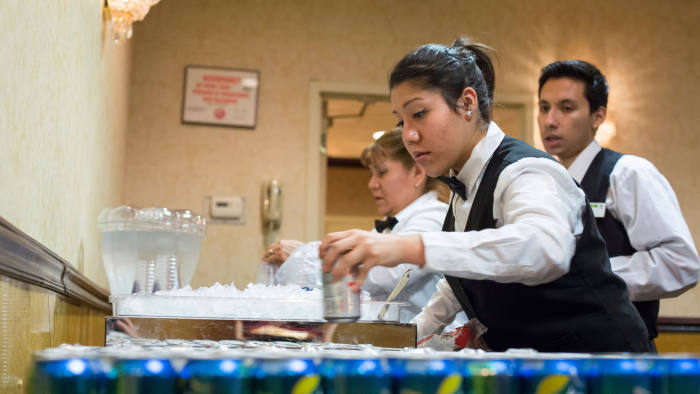 DJ9XNA Chicago, Illinois - Hotel workers prepare drinks for a banquet at the Holiday Inn O'Hare.