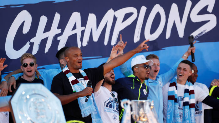 Soccer Football - Manchester City Premier League Title Winners Parade - Manchester, Britain - May 20, 2019 Manchester City's Vincent Kompany with team mates during the celebrations Action Images via Reuters/Lee Smith