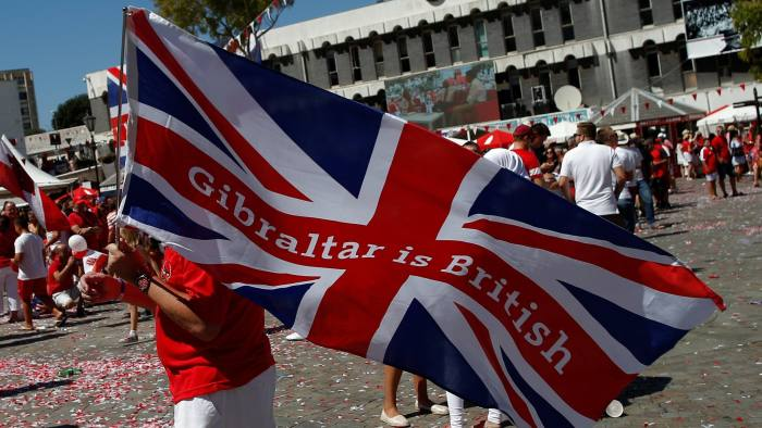 A man waves the Union Jack flag at Casemates square during the Gibraltar National Day celebrations commemorating the 50th anniversary of the referendum, in the British overseas territory of Gibraltar, historically claimed by Spain, September 10, 2017. REUTERS/Jon Nazca