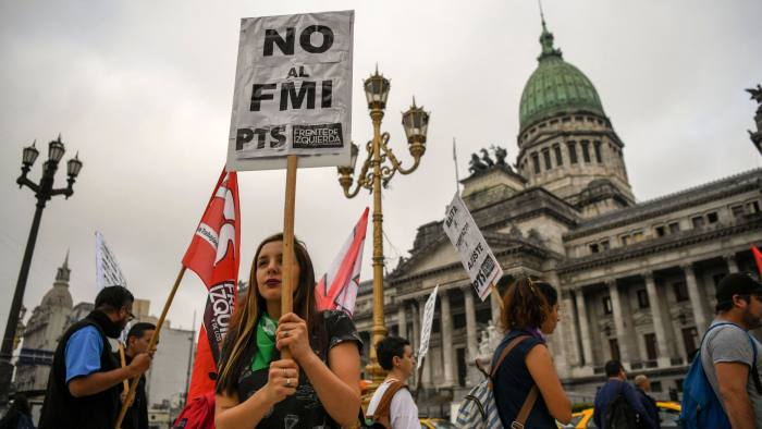 Members of leftist organizations demonstrate outside the National Congress against the government's negotiations with the IMF while legislators debate a bill to put a stop on public services taxes raising in Buenos Aires, on May 09, 2018. Argentina opened talks with the International Monetary Fund on Tuesday to seek a financial aid package, 17 years after the country defaulted on its debt and 12 years after cutting ties with the fund. / AFP PHOTO / EITAN ABRAMOVICHEITAN ABRAMOVICH/AFP/Getty Images