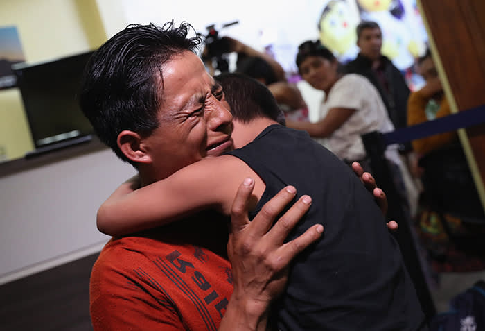 "GUATEMALA CITY, GUATEMALA - AUGUST 07: An emotional father embraces his son for the first time in months on August 7, 2018 in Guatemala City, Guatemala. A group of nine children were flown from New York and reunited with their families, months after U.S. border agents separated them and deported the parents as part of the Trump administration's ""zero tolerance"" policy at the border. Most of the children had been held at the Cayuga Center in New York City. (Photo by John Moore/Getty Images)"