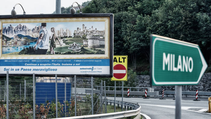 A billboard displays an advertisement for a rest area operated by Autostrade per l'Italia SpA, on the A7 Highway near Genoa, Italy, on Friday, Aug. 24, 2018. Italy's Deputy Prime Minister Matteo Salvini signaled support for a political compromise taking shape following last week's Genoa bridge collapse, saying he favored a government ownership role in toll-road operator Autostrade per l'Italia, but opposed nationalizing the highway network. Photographer: Federico Bernini/Bloomberg