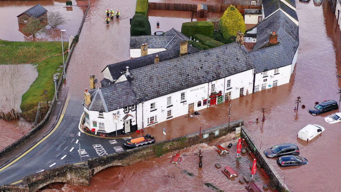 CRICKHOWELL, WALES - FEBRUARY 16: An aerial view of the Welsh village of Crickhowell which has been cut off as the river Usk bursts its banks at Crickhowell bridge near the Bridge End Inn on February 16, 2020 in Crickhowell, Wales. The Met Office have issued a red weather warning for rain in Wales and a yellow weather warning for wind for large parts of the UK as storm Dennis passes over the UK. Last week two people were killed as storm Ciara saw parts of the country hit by 93mph winds. (Photo by Christopher Furlong/Getty Images)