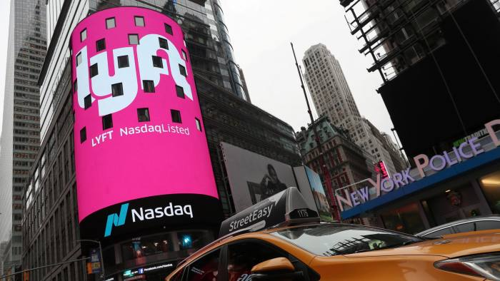 FILE PHOTO: Signage for Lyft is seen displayed at the NASDAQ MarketSite in Times Square in celebration of its initial public offering (IPO) on the NASDAQ Stock Market in New York, U.S., March 29, 2019. REUTERS/Shannon Stapleton/File Photo