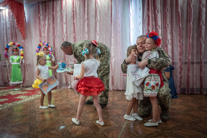 Europe's forgotten war. By David Bond. The conflict in Eastern Ukraine between Russian backed separatists and Ukrainian forces has been raging for 4 years and claimed 10,000 lives yet largely forgotten in the West. Picture shows Ukrainian soldiers visiting a kindergarten near the town of Boudhna.