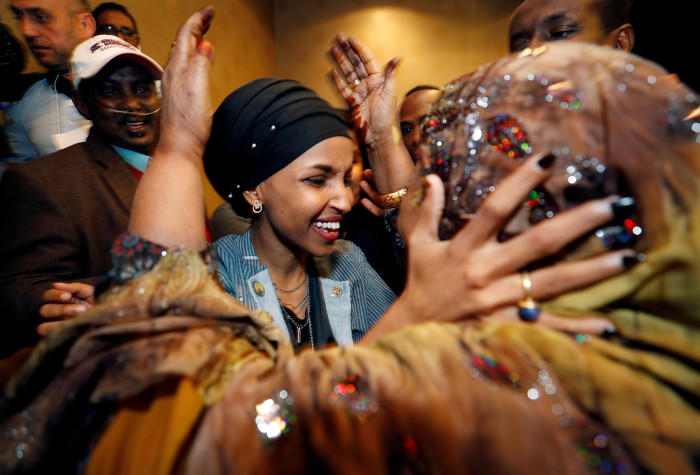 Democratic congressional candidate Ilhan Omar is greeted by her husband's mother after appearing at her midterm election night party in Minneapolis, Minnesota, U.S. November 6, 2018. REUTERS/Eric Miller TPX IMAGES OF THE DAY