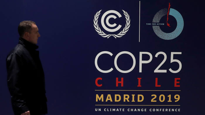 MADRID, SPAIN - NOVEMBER 29: A man walks past a COP25 poster ahead of the United Nations' COP25 climate change summit from 2- 13 December following Chile's withdrawal, as the last preparations continue at the IFEMA fairground in Madrid, Spain on November 29, 2019. (Photo by Burak Akbulut/Anadolu Agency via Getty Images)