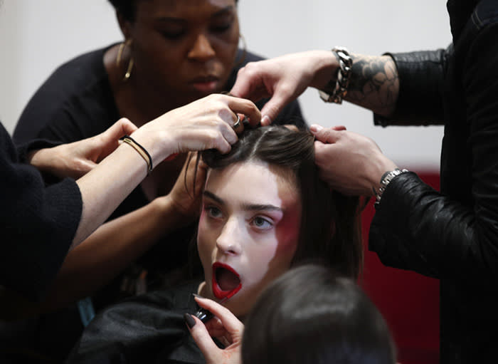 A model is being made up before the presentation of French fashion designer Alexis Mabille's Haute Couture Spring-Summer 2018 fashion collection, in Paris, Tuesday, Jan.23, 2018. (AP Photo/Francois Mori)
