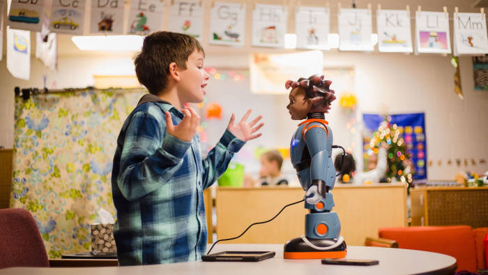 """Devin Chaplin, 7, plays a game of """"Red Light, Green Light"""" with Milo, the robot, during some exercises in Julie Jeffcoat's classroom at Kingsbury Elementary."""