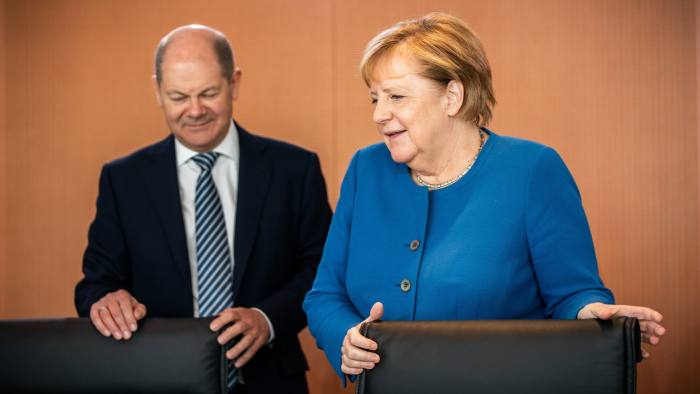 30 October 2019, Berlin: German Chancellor Angela Merkel (R) and Minister of Finance Olaf Scholz arrive to attend the weekly cabinet meeting at the Federal Chancellery. Photo: Michael Kappeler/dpa