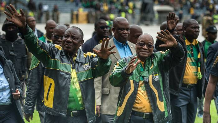 South African President Jacob Zuma (R) and South African ruling party African National Congress (ANC) deputy president Cyril Ramaphosa (L) gesture as they arrive at Orlando Stadium in Soweto on January 8, 2017 for a ceremony marking the 105th ANC's anniversary. South African President Jacob Zuma on January 8, 2017 denounced corruption within the ruling ANC party and admitted that mistakes had cost the party at the ballot box after a year of damaging scandals. / AFP / MUJAHID SAFODIEN (Photo credit should read MUJAHID SAFODIEN/AFP/Getty Images)