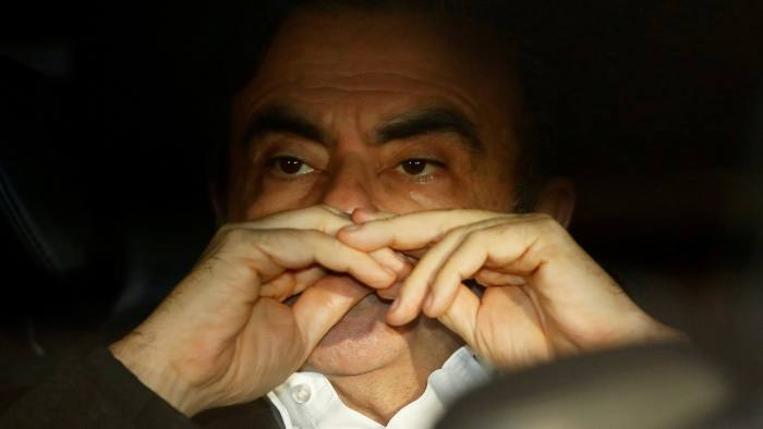 FILE PHOTO: Former Nissan Motor Chairman Carlos Ghosn sits inside the car as he leaves his lawyer's office after being released on bail from Tokyo Detention House, in Tokyo, Japan, March 6, 2019. REUTERS/Issei Kato/File Photo