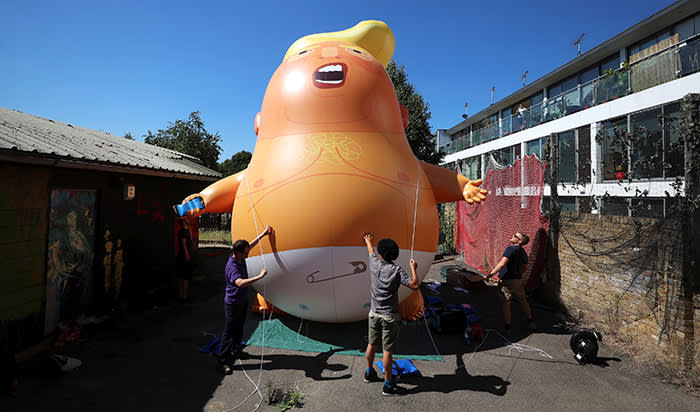 People inflate a helium filled Donald Trump blimp which they hope to deploy during The President of the United States' upcoming visit, in London, Britain, June 26, 2018. REUTERS/Simon Dawson
