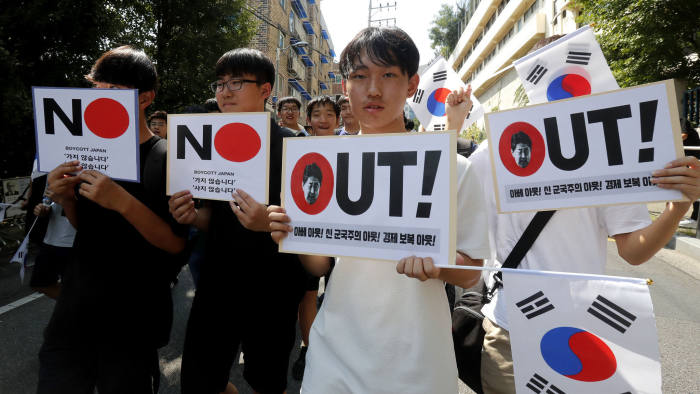 "South Korean middle school students march during a rally against Japan in Seoul, South Korea, Wednesday, Aug. 28, 2019. Japan's downgrading of South Korea's trade status took effect Wednesday, a decision that has already set off a series of reactions hurting bilateral relations. The notice reads: ""Out, Economic retaliation and Japanese Prime Minister Shinzo Abe."" (AP Photo/Ahn Youg-joon)"