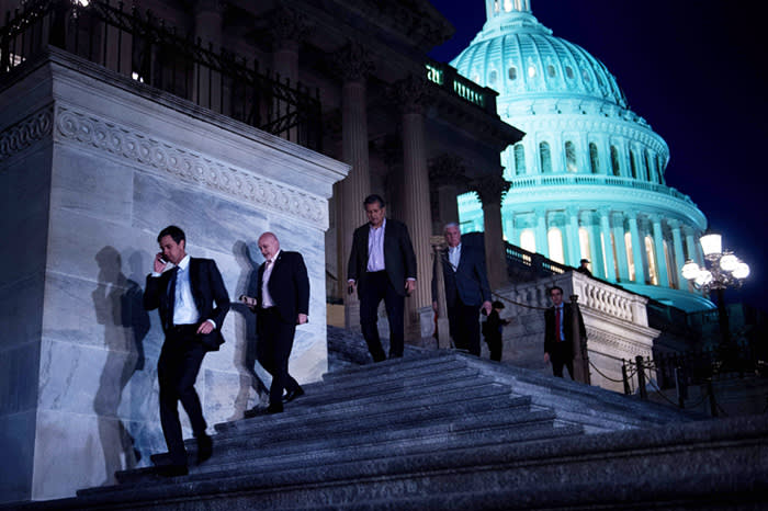 TOPSHOT - Members of the House of Representatives leave after a vote on Capitol Hill after the House and Senate moved to end a government shutdown, on January 22, 2018 in Washington, DC. Lawmakers Monday approved a temporary funding bill that clears the way to ending a three-day government shutdown triggered by feuding over immigration policy. The stopgap bill, which in addition to funding the government through February 8 also reauthorizes a popular children's health insurance program, now heads to the White House where President Donald Trump is expected to sign it into law. / AFP PHOTO / Brendan SmialowskiBRENDAN SMIALOWSKI/AFP/Getty Images