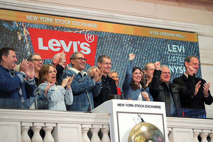 Chip Bergh, centre in black, rings the opening bell at Levi Strauss's IPO in March last year