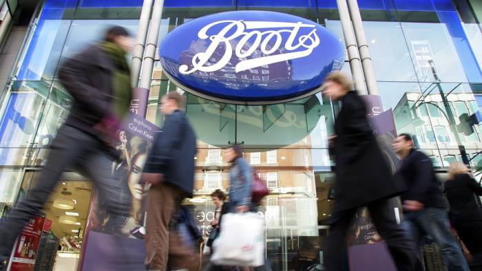 ALLIANCE BOOTS...FILE -  In an Oct. 5, 2005 file photo people walk by a Boots pharmacy in central London.    Drugstore chain Walgreen Co. says it will spend $6.7 billion to buy a stake in health and beauty retailer Alliance Boots.    (AP Photo/Sergio Dionisio)