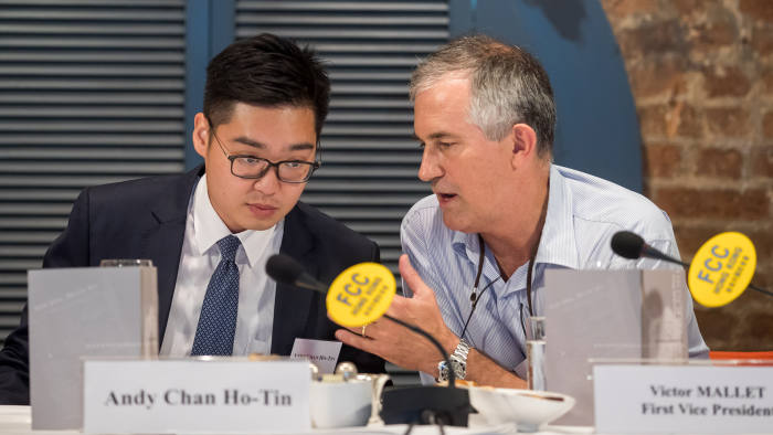 In this photo taken on August 14, 2018, Victor Mallet, a Financial Times journalist and vice president of the Foreign Correspondents' Club (FCC) (R) speaks with Andy Chan, founder of the Hong Kong National Party, during a luncheon at the FCC in Hong Kong. - Hong Kong has refused to renew the visa of a senior Financial Times journalist who hosted a talk by an activist advocating the city's independence from China, the newspaper said on October 5, 2018. (Photo by Paul Yeung / POOL / AFP) (Photo credit should read PAUL YEUNG/AFP/Getty Images)