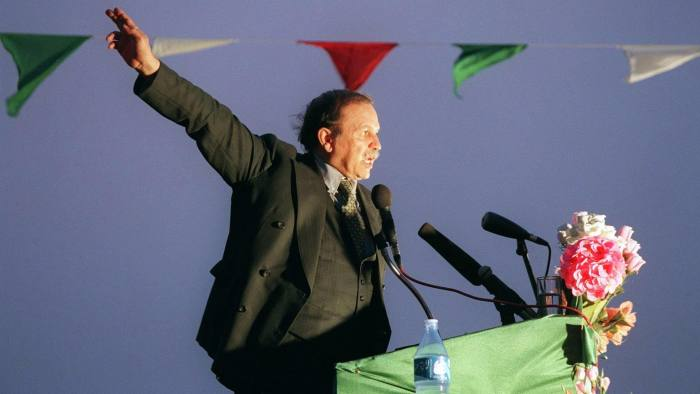 Algerian presidential candidate Abdelaziz Bouteflika, nominally independent but backed by Algeria's former sole ruling party, the National Liberation Front, addresses supporters in Adrar, some 1,400 kms south of Algiers, late 09 April 1999. Algerians will go to the polls 15 April 1999 in an early election to elect a new president to succeed outgoing president Liamine Zeroual who stepped down last September, 19 months before the end of his five-year term. (Photo by MANOOCHER DEGHATI / AFP) (Photo credit should read MANOOCHER DEGHATI/AFP/Getty Images)