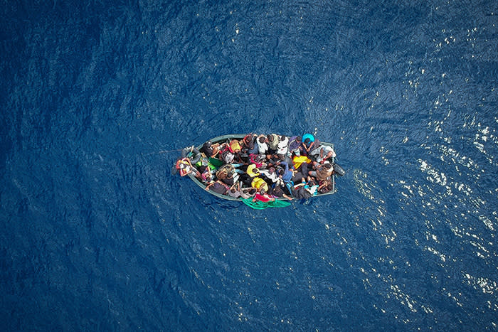 TOPSHOT - An aerial photo shows a boat carrying migrants stranded in the Strait of Gibraltar before being rescued by the Spanish Guardia Civil and the Salvamento Maritimo sea search and rescue agency that saw 157 migrants rescued on September 8, 2018. - While the overall number of migrants reaching Europe by sea is down from a peak in 2015, Spain has seen a steady increase in arrivals this year and has overtaken Italy as the preferred destination for people desperate to reach the continent. Over 33,000 migrants have arrived in Spain by sea and land so far this year, and 329 have died in the attempt, according to the International Organization for Migration. (Photo by Marcos Moreno / AFP)MARCOS MORENO/AFP/Getty Images