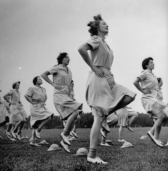 Photo by Marie Hansen. WACs doing daily calisthenics exercises. © LIFE Picture Collection, Meredith Corporation