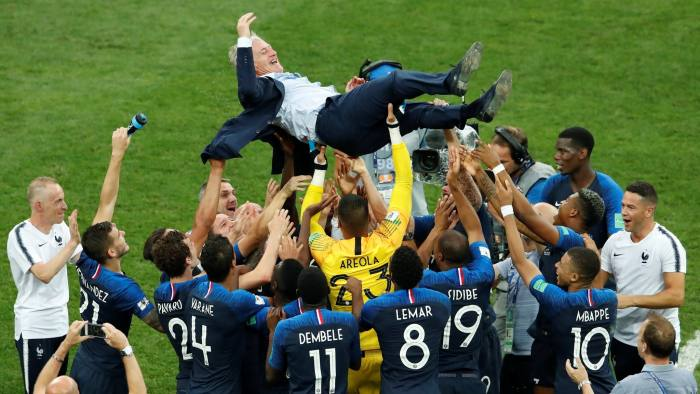 Soccer Football - World Cup - Final - France v Croatia - Luzhniki Stadium, Moscow, Russia - July 15, 2018 France coach Didier Deschamps is thrown into the air by his players as they celebrate after winning the World Cup REUTERS/Maxim Shemetov