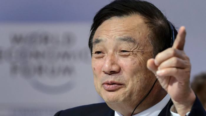 (FILES) In this file photo taken on January 22, 2015 Huawei Founder and CEO Ren Zhengfei gestures as he attends a session of the World Economic Forum (WEF) annual meeting in Davos. - Zhengfei, whose group has become the pet peeve of the United States and who is asking for the extradition of his daughter, described on April 17, 2019 in the German press Donald Trump as