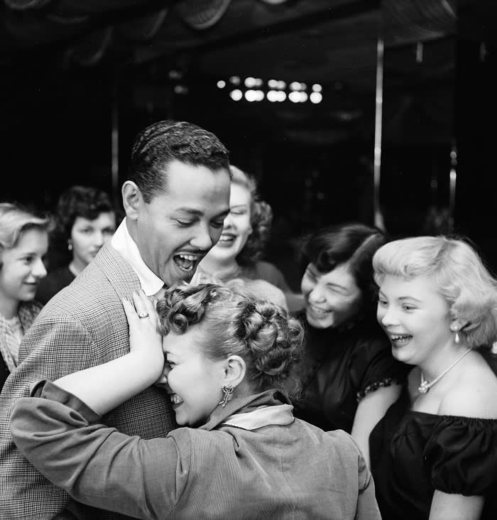 Photo by Martha Holmes. Singer Billy Eckstine getting a hug fr. an adoring female after his show at Bop City. © LIFE Picture Collection, Meredith Corporation