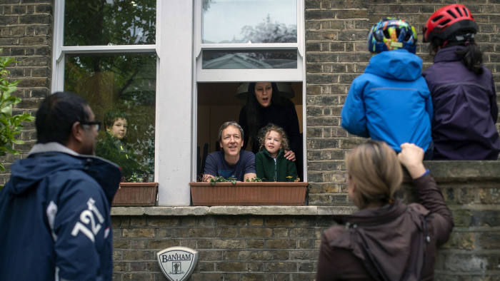 PABest **Parental permission granted** Two families maintain social distancing while talking to each other outside a home in Hampstead, north London, as the UK continues in lockdown to help curb the spread of the coronavirus. PA Photo. Picture date: Sunday May 3, 2020. See PA story HEALTH Coronavirus. Photo credit should read: Victoria Jones/PA Wire