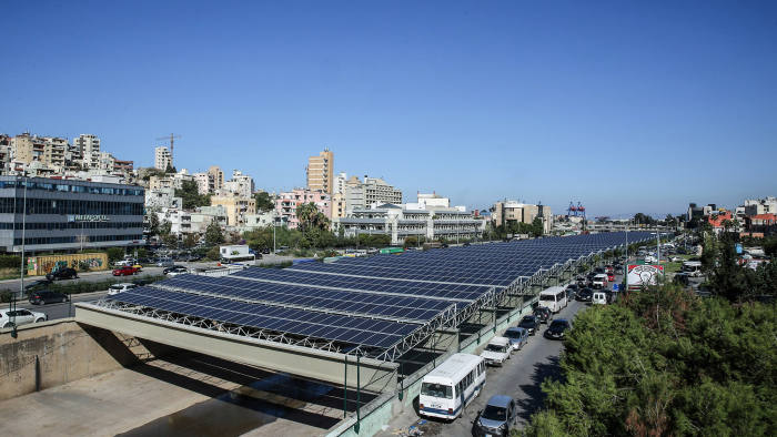 Photovoltaic panels are seen above the river bed in the Lebanese capital, Beirut, on November 12, 2015. As part of the government's National Energy Efficiency Action Plan (NEEAP) to install 200 MW of solar farms by 2020 the construction of the Beirut River Solar Snake (BRSS) project, is the largest of its kind on a national level. BRSS consists of the installation of 10 MW of energy via a photovoltaic (PV) farm stretching across 30 meters of the Beirut River. The PV farm will feature a fully suspended design with no obstruction in the river, offering a capacity of 1.08 MWp. AFP PHOTO / JOSEPH EID / AFP / JOSEPH EID (Photo credit should read JOSEPH EID/AFP/Getty Images)