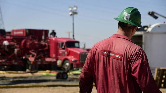 A Halliburton Co. worker walks through an Anadarko Petroleum Corp. hydraulic fracturing (fracking) site north of Dacono, Colorado, U.S., on Tuesday, Aug. 12, 2014. U.S. crude oil inventories rose by 1.4 million barrels in the week ended Aug. 8, to 367 million, compared with the consensus-estimated draw of 1.6 million. Photographer: Jamie Schwaberow/Bloomberg
