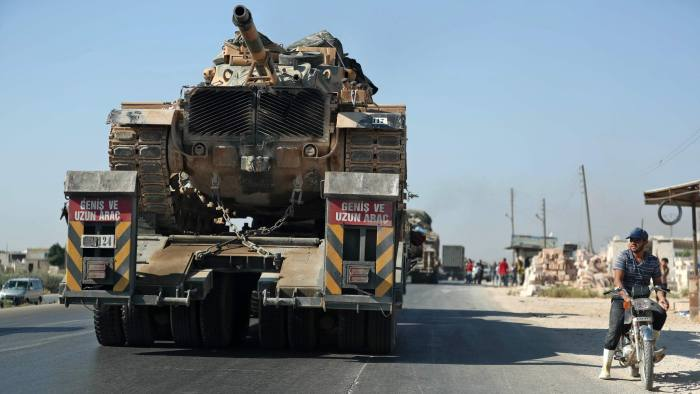TOPSHOT - A convoy of Turkish military vehicles passes through the town of Saraqeb in the northwestern province of Idlib reportedly heading toward the town of Khan Sheikhun in the southern countryside of the province on August 19, 2019. - Damascus today condemned the deployment of a Turkish military convoy towards a key town in northwestern Syria where regime forces are waging fierce battles with jihadists and rebels. (Photo by Omar HAJ KADOUR / AFP)OMAR HAJ KADOUR/AFP/Getty Images