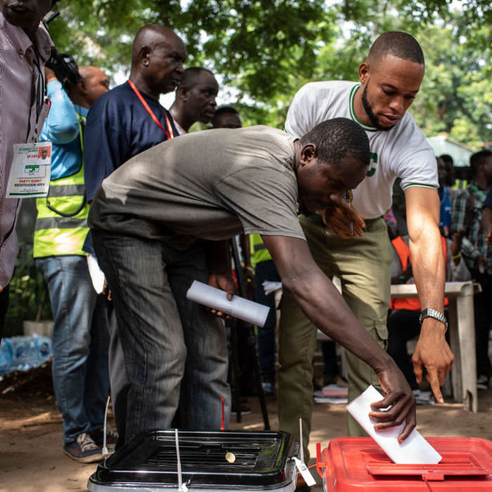 A man puts his ballot papers in the designated ballot boxes at one of the polling units in Lagos on March, 2019. - Nigerians are voting for a second time in a fortnight in governorship and state assembly elections, with heightened concerns from observers of violence and an increased military presence. Elections for governors are being held in 29 of Nigeria's 36 states, for all state assemblies, plus the administrative councils in the Federal Capital Territory of Abuja. (Photo by STEFAN HEUNIS / AFP) (Photo credit should read STEFAN HEUNIS/AFP via Getty Images)