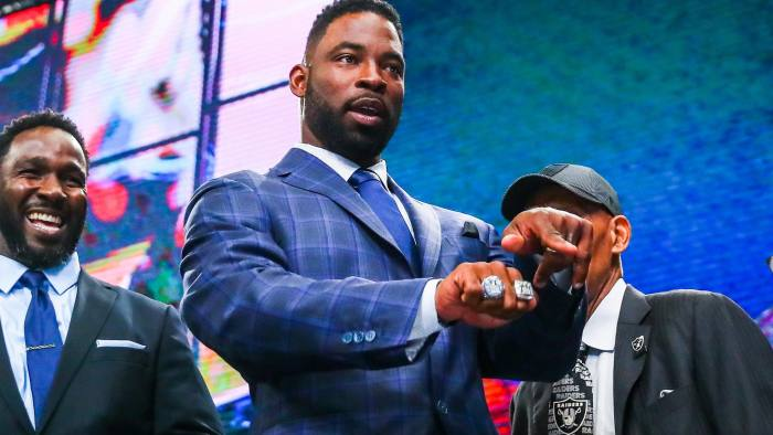 ARLINGTON, TX - APRIL 27: Former New York Giant Justin Tuck shows fans his two Super Bowl Rings during the second round of the 2018 NFL Draft on April 27, 2018, at AT