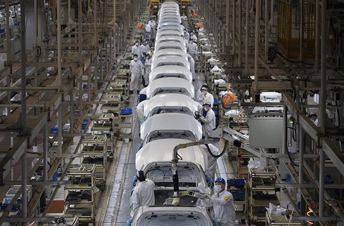 Workers assemble cars at the Dongfeng Honda Automobile factory in Wuhan in central China's Hubei province on Wednesday, April 8, 2020. Wuhan is a major center for heavy industry, particularly autos, and while many major plants have restarted production after a major disruption due to the coronavirus, the small and midsize businesses that employ the most people are still hurting from both a lack of workers and demand. (AP Photo/Ng Han Guan)