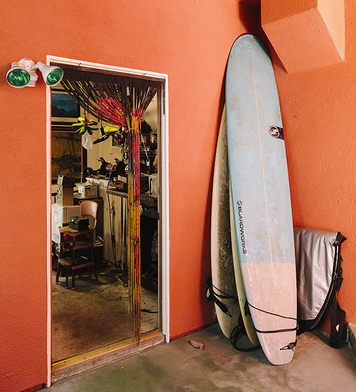 Surfboards stacked up on the back porch (C) Liz Kuball for the FT
