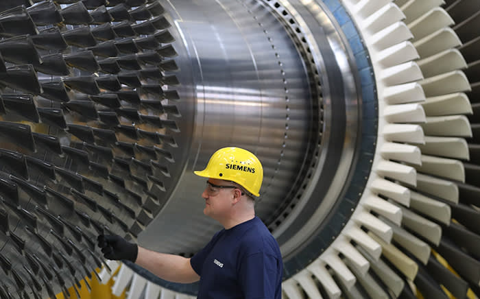 BERLIN, GERMANY - MARCH 02: A worker, at the request of members of the media who were present, touches a turbine at the Siemens gas turbine factory on March 2, 2017 in Berlin, Germany. Germany's number of unemployed fell by 15,000 in February compared to the month before and by 149,000 compared to one year ago. The unemployment rate is currently at 6.3%, which is close to the lowest it has been in 20 years. (Photo by Sean Gallup/Getty Images)