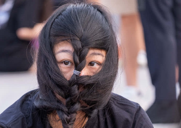 Hair is used to circumvent the ban on masks