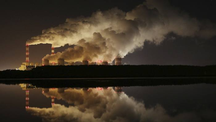 FILE - In this Wednesday, Nov. 28, 2018 file photo, plumes of smoke rise from Europe's largest lignite power plant in Belchatow, central Poland. As politicians haggle at a U.N. climate conference in Poland over ways to limit global warming, the industries and machines powering our modern world keep spewing their pollution into the air and water. The fossil fuels extracted from beneath the earth's crust _ coal, oil and gas _ are transformed into the carbon dioxide that is now heating the earth faster than scientists had expected even a few years ago. (AP Photo/Czarek Sokolowski)