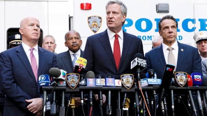 Mandatory Credit: Photo by JUSTIN LANE/EPA-EFE/REX/Shutterstock (9943595e) New York Mayor Bill de Blasio (C), New York Governor Andrew Cuomo (R), and New York Police Commissioner James P. O'Neill (L) and other officials hold a press conference at the scene where an explosive device was found at the CNN's offices in New York, New York, USA, 24 October 2018. According to officials, the package found at CNN contained a live explosive as well as an envelope with suspicious white powder. Explosive Device Found at CNN New York Headquaters, USA - 24 Oct 2018