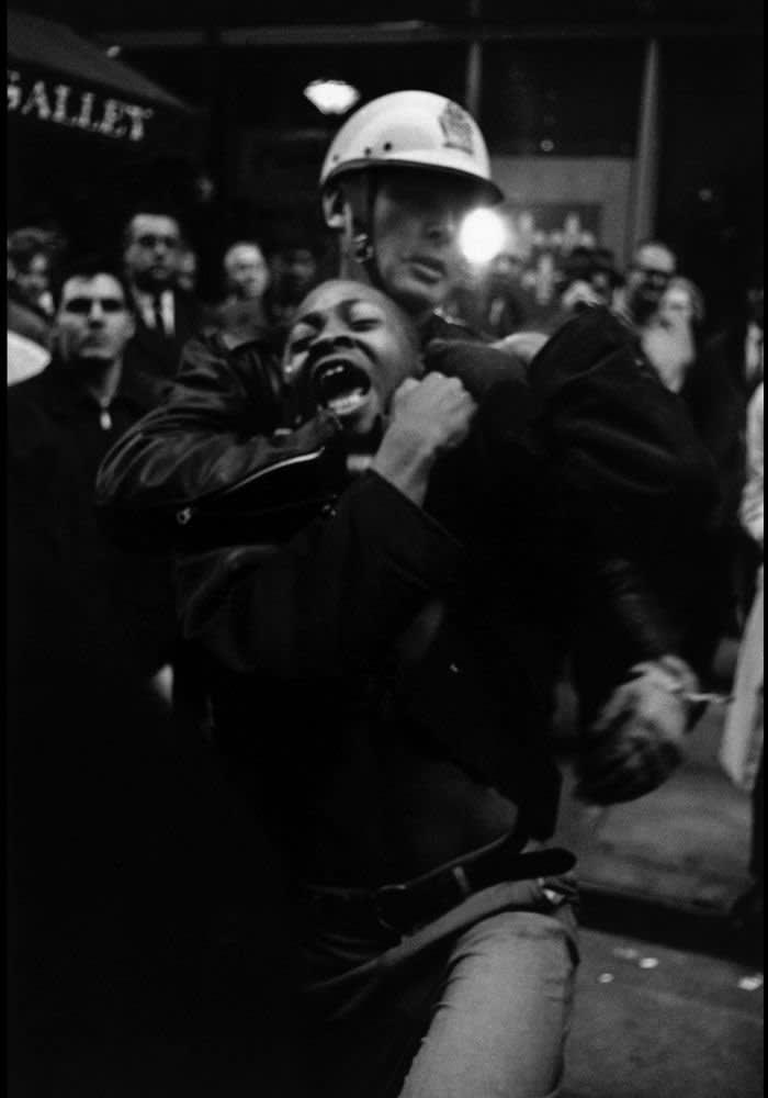 USA. Atlanta, Georgia. Taylor Washington yells as he gets arrested. Winter 1963-1964. Danny Lyon / magnum photos