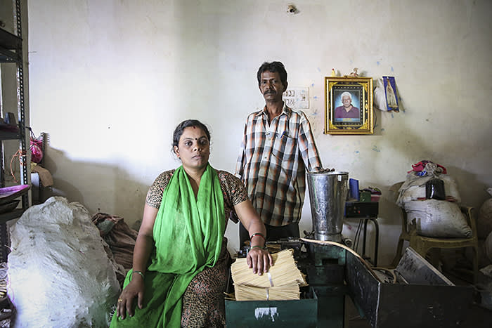Devi and Vijay Kumar pose for a photograph in their incense making workshop in Bangalore, India. Devi is a borrower from Ujjivan and has been able to buy machinery with the help of loans from Ujjivan.