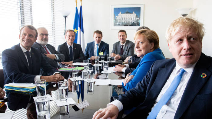 Mandatory Credit: Photo by HAYOUNG JEON/EPA-EFE/Shutterstock (10421964c) President of France Emmanuel Macron (L), German Chancellor Angela Merkel (2R), and British Prime Minister Boris Johnson (R) meet after the United Nations (UN) Climate Action Summit 2019 at the UN headquarters in New York, USA, 23 September 2019. German Chancellor Merkel visits the US to attend the United Nations Climate Summit and General Assembly. German Chancellor Merkel meets British Prime Minister Johnson and French President Macron at UN, New York, USA - 23 Sep 2019