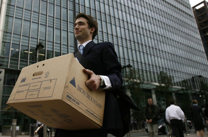 A worker carries a box out of the U.S. investment bank Lehman Brothers in London...A worker carries a box out of the U.S. investment bank Lehman Brothers offices in the Canary Wharf district of London September 15, 2008. The ruptured U.S. financial system faces an unprecedented shake-up with Lehman Brothers filing for bankruptcy, Bank of America buying Merrill Lynch and the Federal Reserve saying for the first time it will accept stocks in exchange for cash loans. REUTERS/Andrew Winning (BRITAIN)