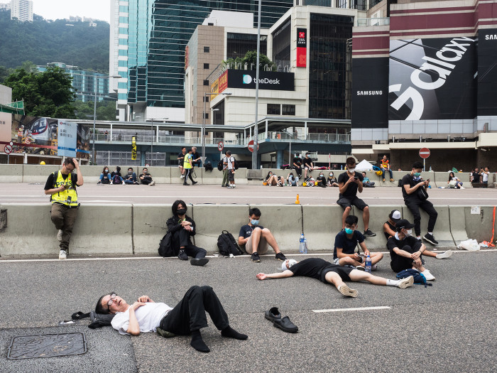 Protesters rest on a road in the Admiralty district in June. The movement is largely leaderless by design, after several Umbrella leaders were sentenced to prison