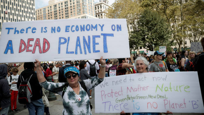 Activists take part in a demonstration as part of the Global Climate Strike in Manhattan in New York, U.S., September 20, 2019. REUTERS/Shannon Stapleton