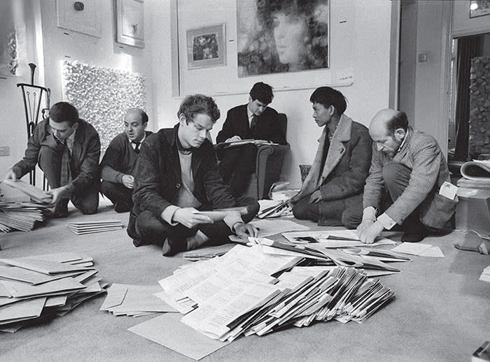 A group of artists sending out a news bulletin at Signals London in 1964
