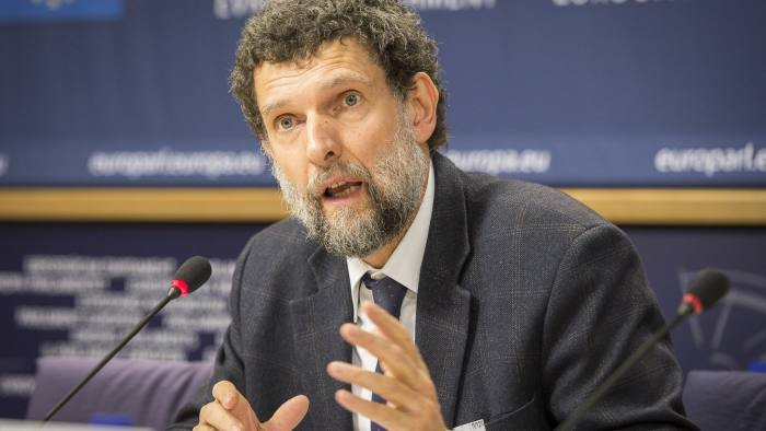FILED - 11 December 2014, Belgium, Brussels: Osman Kavala, Turkish philanthropist, entrepreneur and rights defender, speaks at a press conference at the EU Parliament. An Istanbul court ruled on Tuesday Kavala must remain in jail after more than two years over alleged links to the 2013 anti-government protests. Photo: Wiktor Dabkowski/dpa